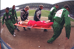 COVENTRY, ENGLAND - Saturday, April 6, 1996: Liverpool's Steve Harkness is carried off on a stretcher with Sammy Lee and physio Mark Leather after having his leg broken by a reckless tackle from Coventry City's John Salako during the Premiership match at Highfield Road. Coventry won 1-0. (Pic by David Rawcliffe/Propaganda)