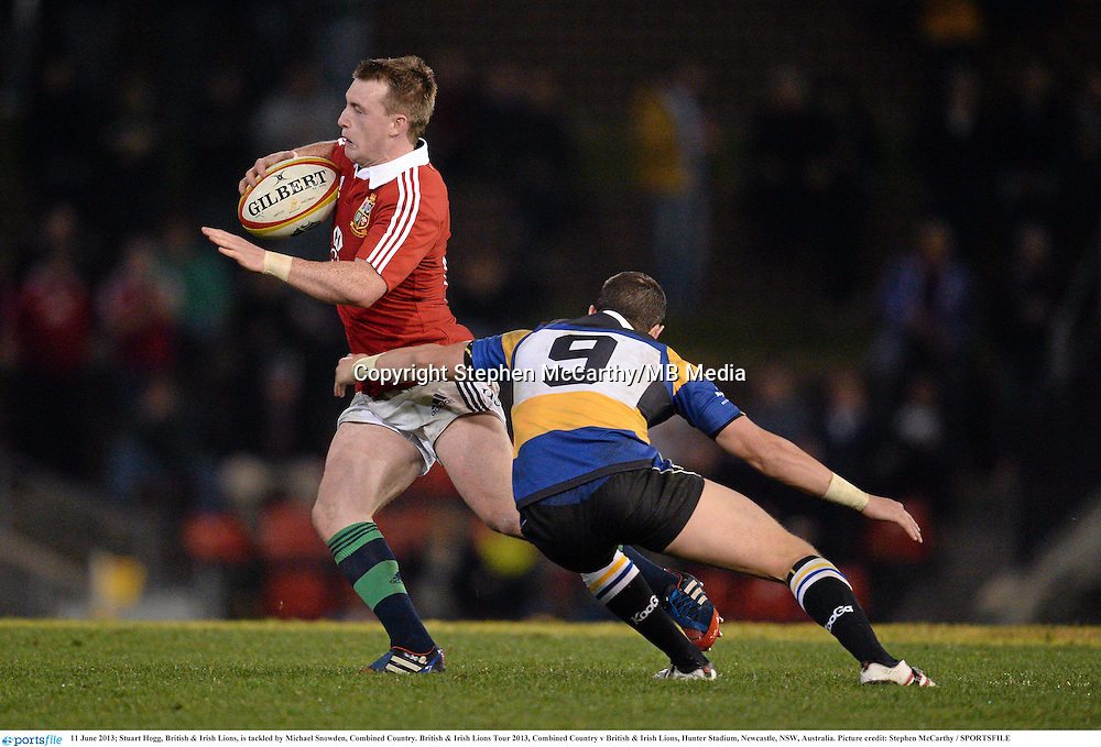 11 June 2013; Stuart Hogg, British & Irish Lions, is tackled by Michael Snowden, Combined Country. British & Irish Lions Tour 2013, Combined Country v British & Irish Lions, Hunter Stadium, Newcastle, NSW, Australia. Picture credit: Stephen McCarthy / SPORTSFILE