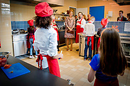 0-4- LELYSTAD - Koningin Maxima opent donderdagochtend 20 april 2017 in Wijkcentrum Zuiderzee in Lelystad het 50e&nbsp;Resto VanHarte. Het 50e&nbsp;Resto is een KinderResto. Kinderen in de leeftijd van 8 tot en met 13 jaar kunnen hier samenkomen om te koken en te leren over voeding, bewegen en samenwerken. Staatssecretaris Klijnsma van Sociale Zaken en Werkgelegenheid is bij de opening aanwezig.COPYRIGHT ROBIN UTRECHT<br /> <br /> 20-4- Lelystad - Queen Maxima opens Thursday morning, April 20, 2017 in Community Center Zuiderzee in Lelystad 50th Resto VanHarte. The 50th Resto is a Kids Resto. Children aged 8 to 13 years old can come together to cook and learn about nutrition, exercise and work. Klijnsma State Secretary for Social Affairs and Employment at the opening aanwezig.COPYRIGHT ROBIN UTRECHT