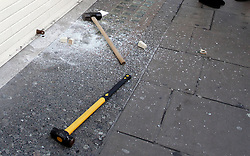 © Licensed to London News Pictures. 20/12/2011. London, United Kingdom .Sledge hammers, and a dropped Rolex watch, used to smash the window of Leslie Davis jewellers. .ttempted robbery on a jewellery shop on Oxford Street by persons on two motorbikes..Photo credit : Chris Winter/LNP