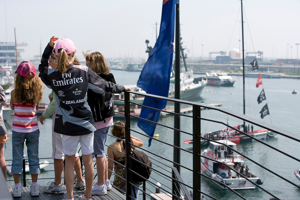 20/04/07..The families of the Emirates Team New Zealand members wave goodbye as the race yacht leaves the base on Day 1 of the Louis Vuitton Cup 2007, Valencia, Spain...