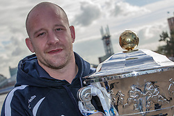 © Licensed to London News Pictures . 26/10/2012 . Salford , UK . Paul Jackson of Scotland holds the cup . Press conference marking a one year countdown to the start of the 2013 Rugby League World Cup , which is being hosted by England and Wales . Photo credit : Joel Goodman/LNP