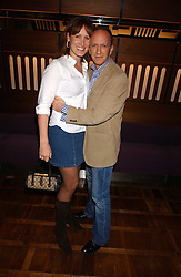 SIMON & SANTA SEBAG-MONTEFIORE she is the sister of Tara Palmer-Tomkinson at a party to celebrate the publication of 'E is for Eating' by Tom Parker Bowles held at Kensington Place, 201 Kensington Church Street, London W8 on 3rd November 2004.<br />