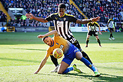 Mansfield Town midfielder CJ Hamilton and Notts County midfielder Mitch Rose (26) during the EFL Sky Bet League 2 match between Notts County and Mansfield Town at Meadow Lane, Nottingham, England on 16 February 2019.