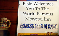 The sign at the bar in the village of Monowi, Nebraska claims to have the coldest beer in town - true since its the only bar in town April 27, 2011. Elsie Eiler, who runs the bar, is the only person living in Monowi making it the only incorporated town, village or city in the United States with just one resident.  REUTERS/Rick Wilking (UNITED STATES)