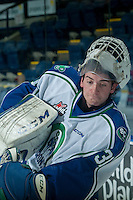 KELOWNA, CANADA - OCTOBER 7: Travis Child #31 of Swift Current Broncos passes the puck during warm up against the Kelowna Rockets on October 7, 2014 at Prospera Place in Kelowna, British Columbia, Canada.  (Photo by Marissa Baecker/Getty Images)  *** Local Caption *** Travis Child;