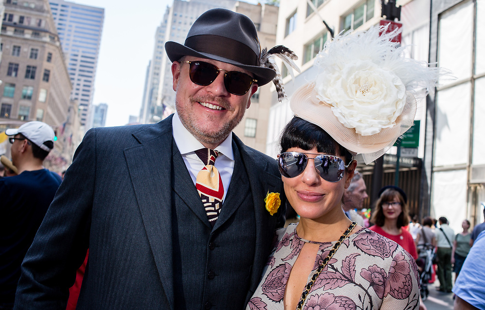 New York, NY - April 16, 2017. A nattily dressed man and woman New York's annual Easter Bonnet Parade and Festival on Fifth Avenue.