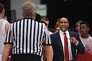 November 14, 2014; Stanford, CA, USA; Stanford Cardinal head coach Johnny Dawkins (right) argues with an official against the Wofford Terriers during the first half at Maples Pavilion.