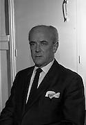 4/3/1965<br /> 3/4/1965<br /> 4 March 1965<br /> <br /> Photo of R.G. Duggan of Duggan Insurance on Suffolk St.