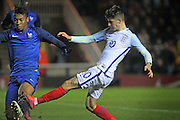 England U18 midfielder Mason Mount (10) with a late tackle during the U18 International match between England and France at London Road (ABAX Stadium), Peterborough, England on 14 November 2016. Photo by Nigel Cole.