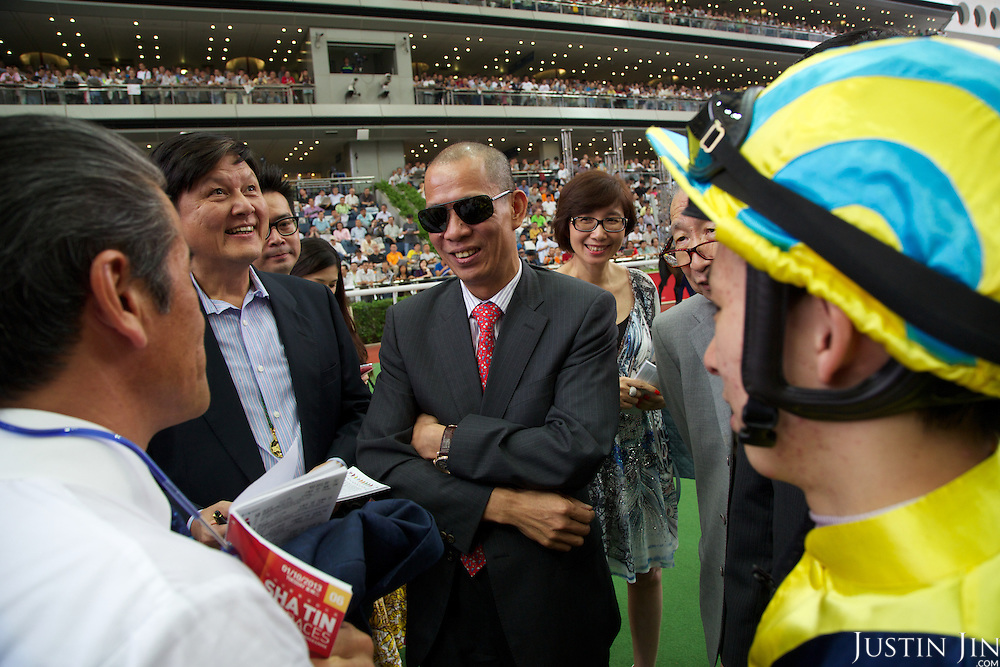 Unidentified horse owners at the Hong Kong Jockey Club's Shatin Racecourse.