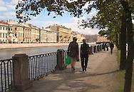 A couple walking along the Fontanka Canal<br /> St. Petersburg,  Russia<br /> c. Ellen Rooney
