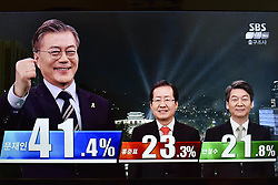 May 9, 2017 - Seoul, SOUTH KOREA - South Korean voters have overwhelmingly chosen the liberal candidate Moon Jae-in(Democratic Party) as their next president, an exit poll suggests..It put Mr Moon on 41.4%, with his nearest challenger, conservative Hong Joon-Pyo(Liberty Korea Party), on 23.3% (Credit Image: © Chris Jung via ZUMA Wire)