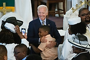 Democratic presidential hopeful former Vice President Joe Biden embraces a young boy following the Sunday service at the Morris Brown AME Church July 7, 2019 in Charleston, South Carolina. South Carolina, called the First in the South, is the first southern democratic primary in the presidential nomination race.