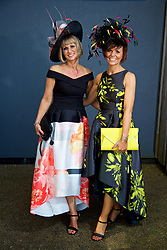 LIVERPOOL, ENGLAND - Thursday, April 6, 2017: Tracey Allen, 43, and Rachael Sherwen, 45, both from Whitehaven, wearing dresses from Coast, during The Opening Day on Day One of the Aintree Grand National Festival 2017 at Aintree Racecourse. (Pic by David Rawcliffe/Propaganda)
