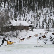 Yukon Quest 2007 at Eagle,<br /> Brent Sass travels on a frozen creek alongside the Taylor Highway outside Eagle.