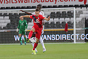 midfielder James Berrett comes away with the ball from forward Eder during the Capital One Cup match between Swansea City and York City at the Liberty Stadium, Swansea, Wales on 25 August 2015. Photo by Simon Davies.