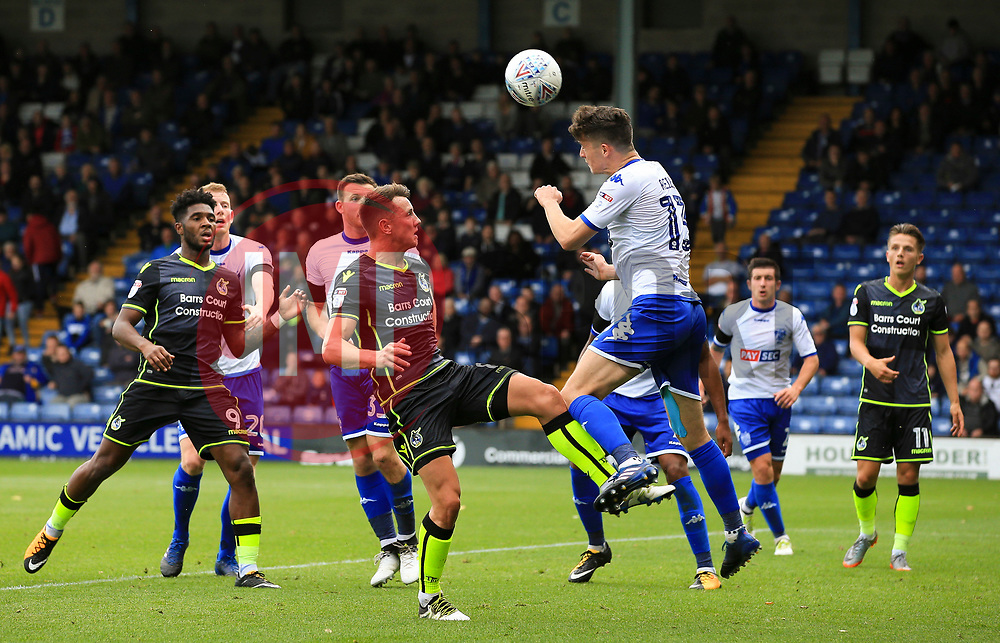 Callum Reilly of Bury clears with a header under pressure from Ollie Clarke of Bristol Rovers - Mandatory by-line: Matt McNulty/JMP - 19/08/2017 - FOOTBALL - Gigg Lane - Bury, England - Bury v Bristol Rovers - Sky Bet League One