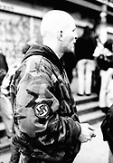 A man with a shaved head wears an anti-Nazi patch.