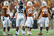 AUSTIN, TX - SEPTEMBER 14: Members of the Texas Longhorns offensive line Sedrick Flowers #66, Dominic Espinosa #55 and Trey Hopkins #75 line up against the Mississippi Rebels on September 14, 2013 at Darrell K Royal-Texas Memorial Stadium in Austin, Texas.  (Photo by Cooper Neill/Getty Images) *** Local Caption *** Sedrick Flowers; Dominic Espinosa; Trey Hopkins