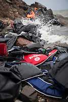 Life jackets and the remains of inflatable boats are strewn on a beach near Mytilene on the Greek island of Lesbos, remnants of the journey from Turkey that hundreds of thousands of Europe-bound migrants have made in 2015.