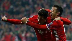 February 15, 2017 - Munich, Germany - Bayern Munich's THIAGO ALCANTARA, right, celebrates scoring their third goal with teammate ROBERT LEWANDOWSKI during UEFA Champions League Round of 16 First Leg action against Arsenal at Allianz Arena. (Credit Image: © Michaela Rehle/Action Images via ZUMA Press)