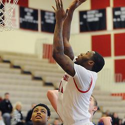 Staff photos by Tom Kelly IV<br /> Coatesville's Jaquan Hollingshed (12) goes up for a layup during the Downingtown West at Coatesville boys basketball game on Saturday afternoon January 4, 2014.