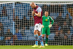 Philippe Senderos of Aston Villa looks dejected after Romain Vincelot of Leyton Orient (not pictured) scores late on to give his side a 0-1 lead - Photo mandatory by-line: Rogan Thomson/JMP - 07966 386802 - 27/08/2014 - SPORT - FOOTBALL - Villa Park, Birmingham - Aston Villa v Leyton Orient - Capital One Cup Round 2.