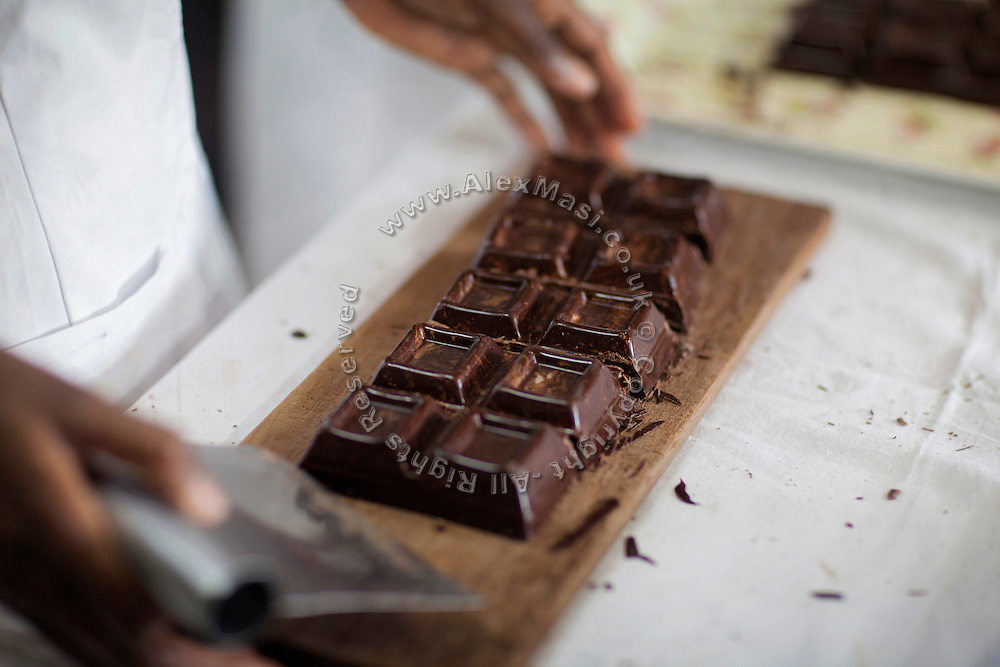 The chocolate produced by Claudio Corallo is being cut by a worker, in his laboratory on the island of Sao Tome, Sao Tome and Principe, (STP) a former Portuguese colony in the Gulf of Guinea, West Africa.