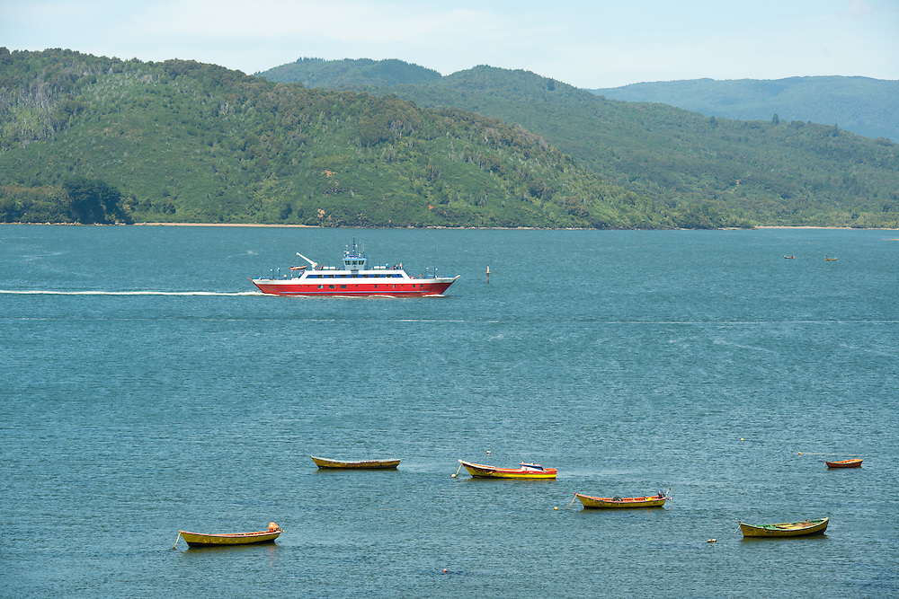Fishing Boats with  Ferry Boat and Mountains in Background, Chile
