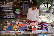 Phnom Penh, Cambodia. Tuol Sleng Genocide Museum at the former Security Prison 21 (S-21) of the Khmer Rouge.<br /> Books and souvenirs.