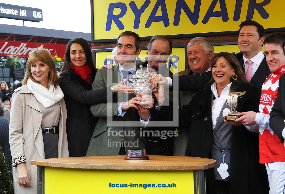 Picture by John Hoy/Focus Images Ltd. 07583422396.15/03/12.James Nesbitt collecting the trophy for the Ryan Air Chase, Cheltenham Race Course, Gloucestershire.
