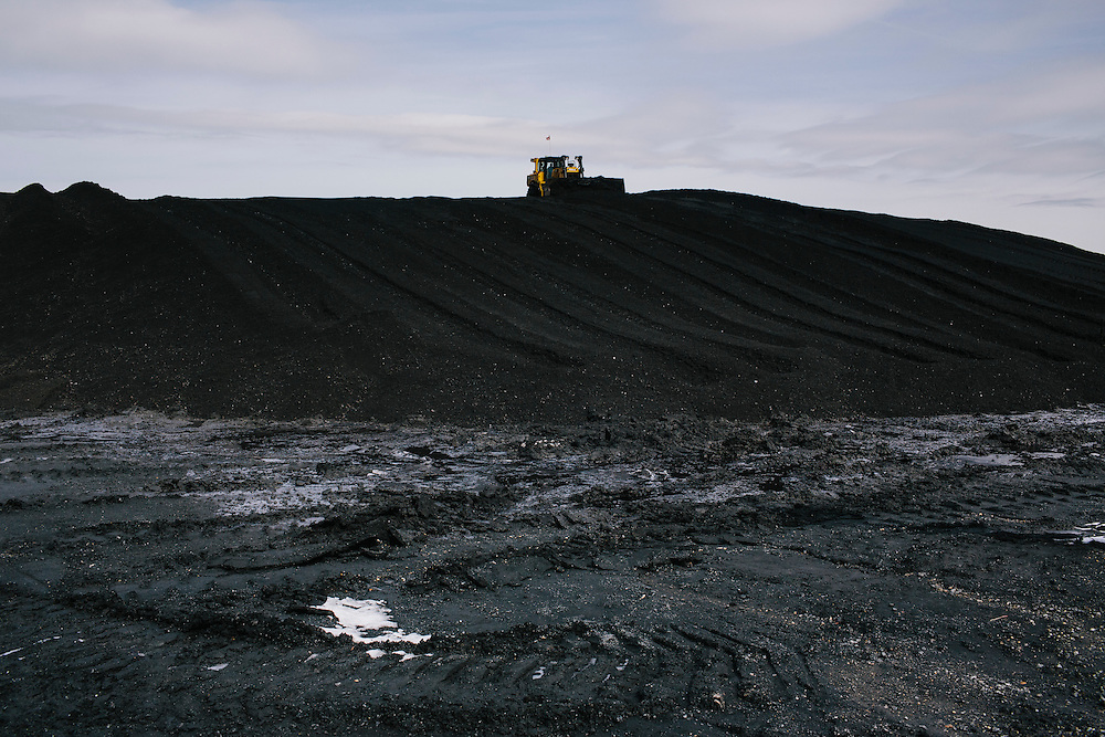 Bulldozers shape mounds of coal based on the type to ensure no collapsing or sliding based on the geometric makeup at Consol Energy's Baltimore Terminal on March 6, 2014. The facility is one of the main areas for foriegn-bound coal.