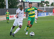 Tampa Bay Rowdies forward Sebastian Guenzatti(13) and Swope Park Rangers defender Mark Segbers(43) battle for the ball during a USL soccer game, Sunday, May 26, 2019, in St. Petersburg, Fla. The Rowdies defeated the Rangers 1-0. (Brian Villanueva/Image of Sport)