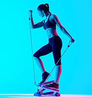 one mixed races woman exercsing Stepper fitness exercices isolated on blue blackground