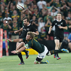 JOHANNESBURG, SOUTH AFRICA - OCTOBER 05: Duane Vermeulen of South Africa tackling Conrad Smith of New Zealand during The Rugby Championship match between South Africa and New Zealand at Ellis Park on October 05, 2013 in Johannesburg, South Africa. (Photo by Steve Haag/Gallo Images)