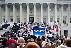 As the funeral processional for Teddy Kennedy made its way to Washington, DC, hundreds gathered at the National Capitol to catch a glimpse as his hurse.