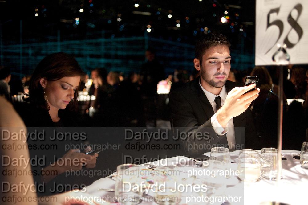 JANET MONTGOMERY; JASON MONTGOMERY, Grey Goose Winter Ball to Benefit the Elton John AIDS Foundation. Battersea park. London. 29 October 2011. <br /> <br />  , -DO NOT ARCHIVE-© Copyright Photograph by Dafydd Jones. 248 Clapham Rd. London SW9 0PZ. Tel 0207 820 0771. www.dafjones.com.