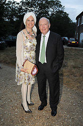 EMMA KITCHENER-FELLOWES and JULIAN FELLOWES leaving a summer party hosted by Lady Annabel Goldsmith at her home Ormeley Lodge, Ham Gate, Richmond on 13th July 2010.