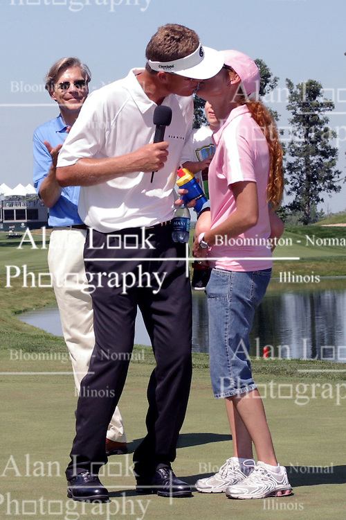 16 July 2006 John Senden kisses his wife after winning the tournament. The John Deere Classic is played at TPC at Deere Run in Silvis Illinois, just outside of the Quad Cities