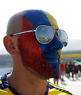 A Colombia fan with the stadium reflected in his sunglasses during the 2014 FIFA World Cup last 16 match at Maracana Stadium, Rio de Janeiro, Brazil.<br /> Picture by Andrew Tobin/Focus Images Ltd +44 7710 761829<br /> 28/06/2014