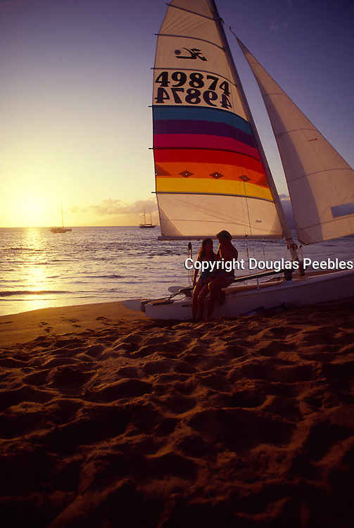 Sunset with couple, Kaanapali Beach, Maui, Hawaii<br />
