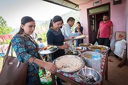 17 September 2018, Biruwa, Kavre district, Nepal: What may appear an ordinary lunch is in fact quite special. As Dalits find themselves among the most marginalized in Nepal society, members of other castes will often not receive food from them even if offered. Today, however, a range of visitors, including local authority officials sit and eat with them, to affirm the equality and dignity of all people, no matter their ethnic group, economic situation, or caste. The Lutheran World Federation World Service programme runs a Post-Earthquake Rehabilitation and Livelihood Recovery Project, in which Biruwa is one of the supported communities.