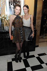 Left to right, BEN GRIMES and AMBER LE BON at the launch of the Claridge's Christmas Tree designed by John Galliano for Dior held at Claridge's, Brook Street, London on 1st December 2009.