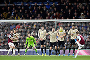 Burnley midfielder Johann Gudmundsson (7) lifts the free kick over the Manchester United wall during the Premier League match between Burnley and Manchester United at Turf Moor, Burnley, England on 28 December 2019.