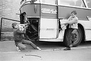 Neville and friend ripping up a school coach, London, 1980s.