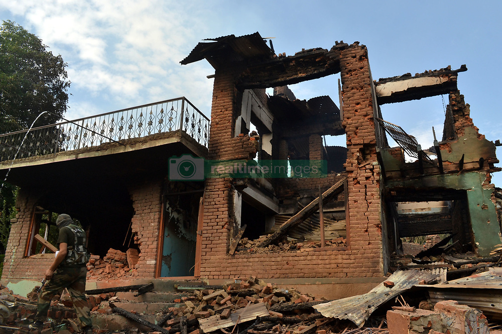 July 3, 2017 - Pulwama, Jammu & Kashmir, India - The completely damaged where militants had taken refuge during a gun battle at Bamnoo village. Two local militants Jehangir Khanday and Kifayat and a fellow non-local militant were killed after troops cordoned off the southern Pulwama area overnight following a tip that militants were hiding there, police said. The gun battle ended 28 hours and soldiers recovered the bodies of three militants. (Credit Image: © Muneeb Ul Islam/Pacific Press via ZUMA Wire)