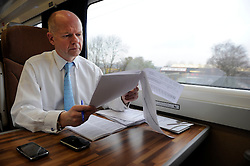 Foreign Secretary William Hague working on the train on his way to visit The Kingswood School in Corby with PPC Louise Bagshawe, Thursday February 4, 2010. Photo By Andrew Parsons/ i-Images.