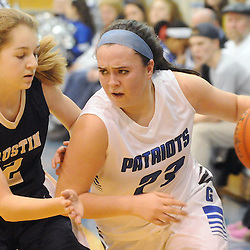 Staff photos by Tom Kelly IV<br /> Great Valley's Danielle DiSanto (23) dribbles past Rustin's Lexi Zavitsky (2) during the West Chester Rustin at Great Valley girls basketball game on Thursday night, January 9, 2014.