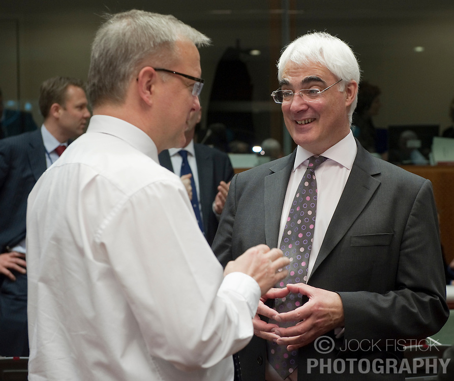 Olli Rehn, The EU's economic and monetary affairs commissioner, left, speaks with Allistar Darlling, the UK's chancellor of the exchequer,  during the meeting of European Union finance ministers, at the EU headquarters in Brussels, Belgium, on Tuesday, March 16, 2010. (Photo © Jock Fistick)